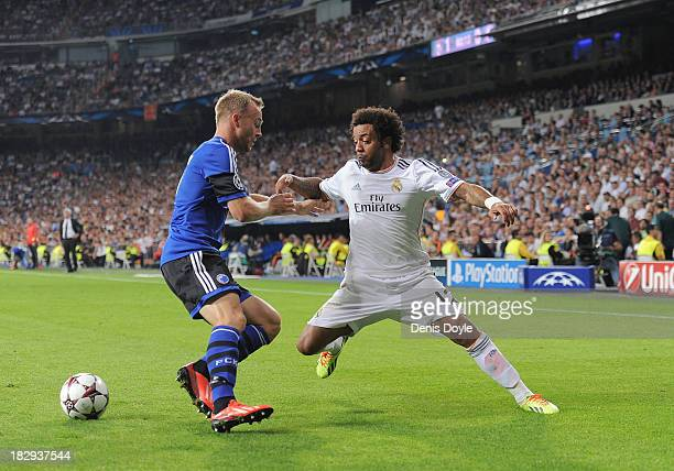 Marcelo of Real Madrid CF beats Lars Jacobsen of FC Copenhagen during the UEFA Champions League match between Real Madrid CF and FC Copenhagen at...
