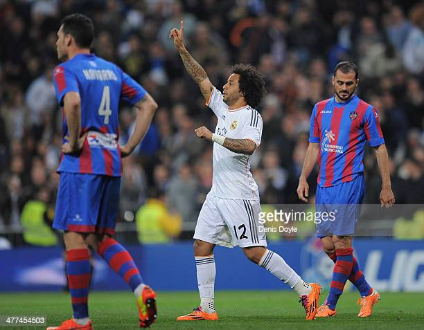 Marcelo of Real Madrid CF celebrates after scoring Real's 2nd goal during the La Liga match between Real Madrid CF and Levante UD at Santiago...