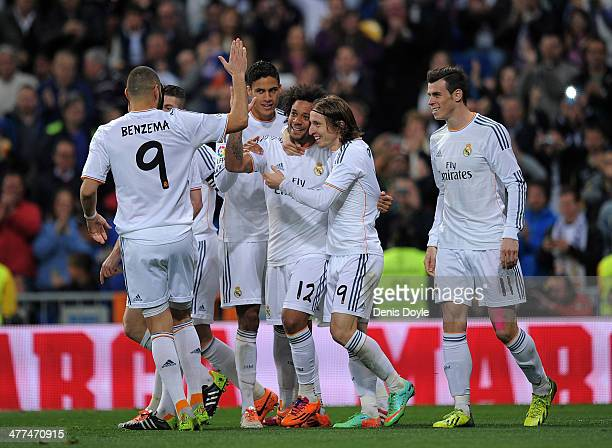 Marcelo of Real Madrid CF celebrates Karim Benzema Gareth Bale and Luka Modric after he scored Real's 2nd goal during the La Liga match between Real...