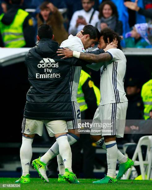 Marcelo of Real Madrid CF celebrates scoring their second goal with teammates Alvaro Morata and James Rodriguez during the La Liga match between Real...