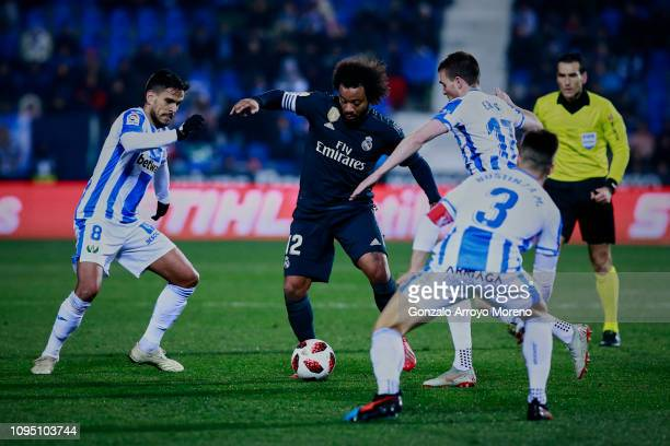 Marcelo of Real Madrid CF competes for the ball with Jose Luis edel Pozo alias Recio and Javier Eraso of Deportivo Leganes during the Copa del Rey...