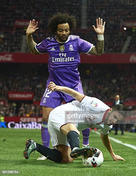 Marcelo of Real Madrid CF competes for the ball with Pablo Sarabia of Sevilla FC during the Copa del Rey Round of 16 Second Leg match between Sevilla...
