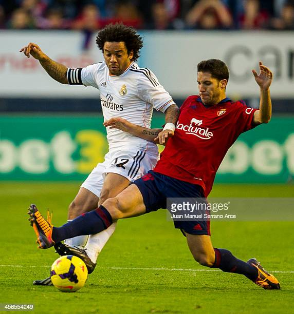Marcelo of Real Madrid CF duels for the ball with Alvaro Cejudo of CA Osasuna during the La Liga match between CA Osasuna and Real Madrid CF at...