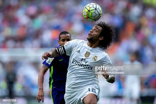 Marcelo of Real Madrid CF heads the ball during the La Liga match between Real Madrid CF and Malaga CF at Estadio Santiago Bernabeu on September 26...