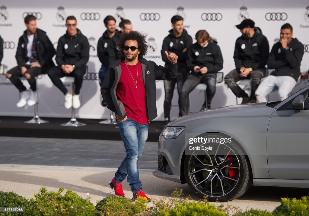 Marcelo of Real Madrid CF poses for a photograph after being presented with a new Audi car as part of an ongoing sponsorship deal with Real Madrid at their Ciudad Deportivo training grounds on November 23, 2017 in Madrid, Spain.
