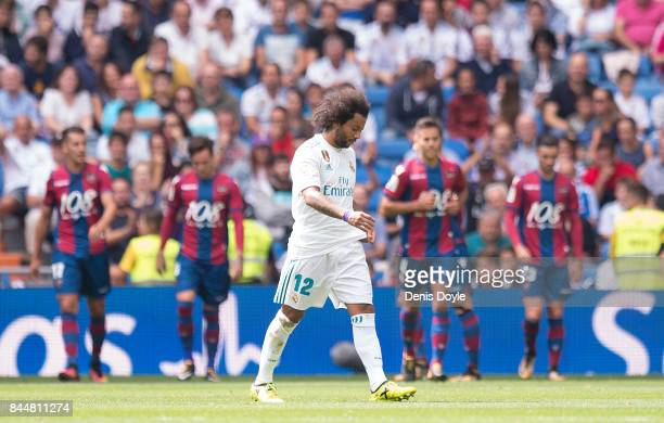 Marcelo of Real Madrid CF reacts after Levante scored their opening goal during the La Liga match between Real Madrid and Levante at Estadio Santiago...