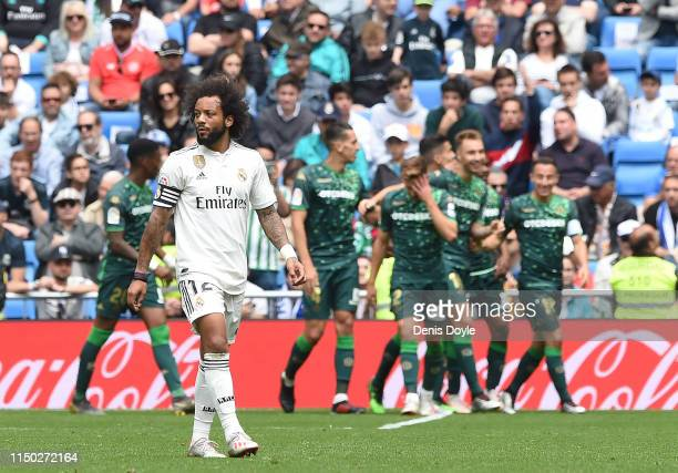 Marcelo of Real Madrid CF reacts after Real Betis Balompie scored their 2nd goal during the La Liga match between Real Madrid CF and Real Betis...