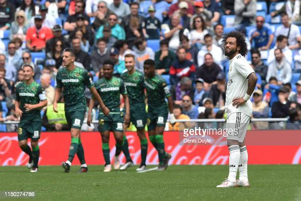 Marcelo of Real Madrid CF reacts after Real Betis Balompie scored their 1st goal during the La Liga match between Real Madrid CF and Real Betis...