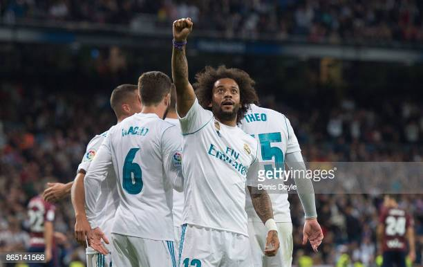 Marcelo of Real Madrid CF tries to shoot past Marko Dmitrovic of Eibar during the La Liga match between Real Madrid and Eibar at Estadio Santiago...