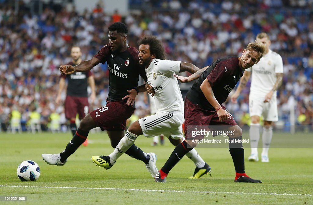 Marcelo of Real Madrid competes for the ball with Franck Kessie of AC Milan during the Trofeo Santiago Bernabeu match between Real Madrid and AC Milan at Estadio Santiago Bernabeu on August 11, 2018 in Madrid, Spain.