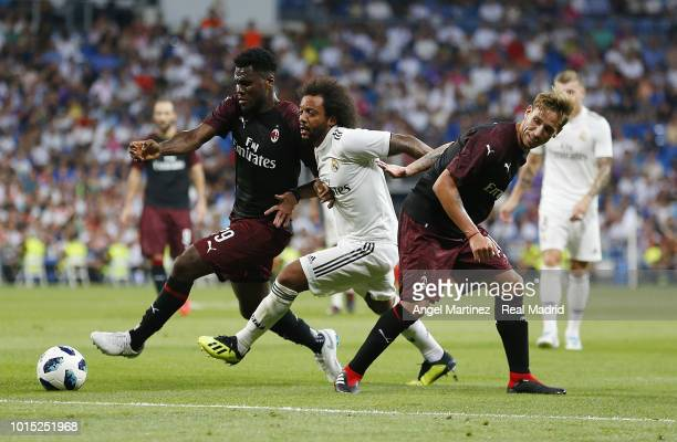 Marcelo of Real Madrid competes for the ball with Franck Kessie of AC Milan during the Trofeo Santiago Bernabeu match between Real Madrid and AC...