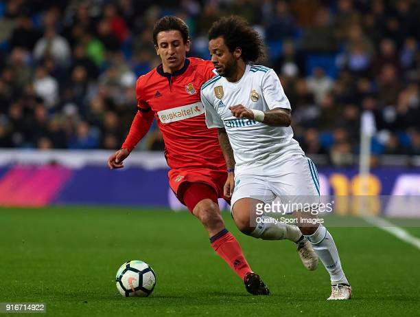 Marcelo of Real Madrid competes for the ball with Mikel Oyarzabal of Real Sociedad during the La Liga match between Real Madrid and Real Sociedad at...