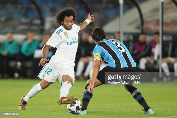 Marcelo of Real Madrid competes with Pedro Geromel of Gremio FBPA during the FIFA Club World Cup UAE 2017 final match between Gremio and Real Madrid...