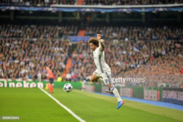Marcelo of Real Madrid controls the ball during the UEFA Champions League Round of 16 first leg match between Real Madrid CF and SSC Napoli at...