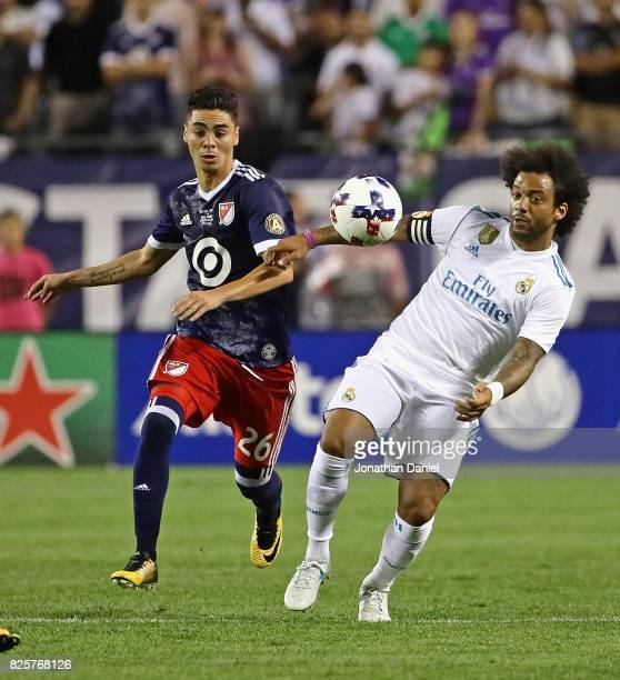 Marcelo of Real Madrid controls the ball off of his chest in front of Miguel Almiron of the MLS AllStars during the 2017 MLS All Star Game at Soldier...