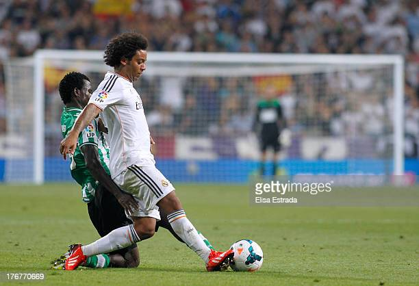 Marcelo of Real Madrid gives a pass during the La Liga match between Real Madrid CF and Real Betis at Estadio Santiago Bernabeu on August 18 2013 in...