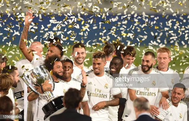 Marcelo of Real Madrid holds the La Liga trophy after Real beat Villarreal 2-1 in the Liga match between Real Madrid CF and Villarreal CF at Estadio...
