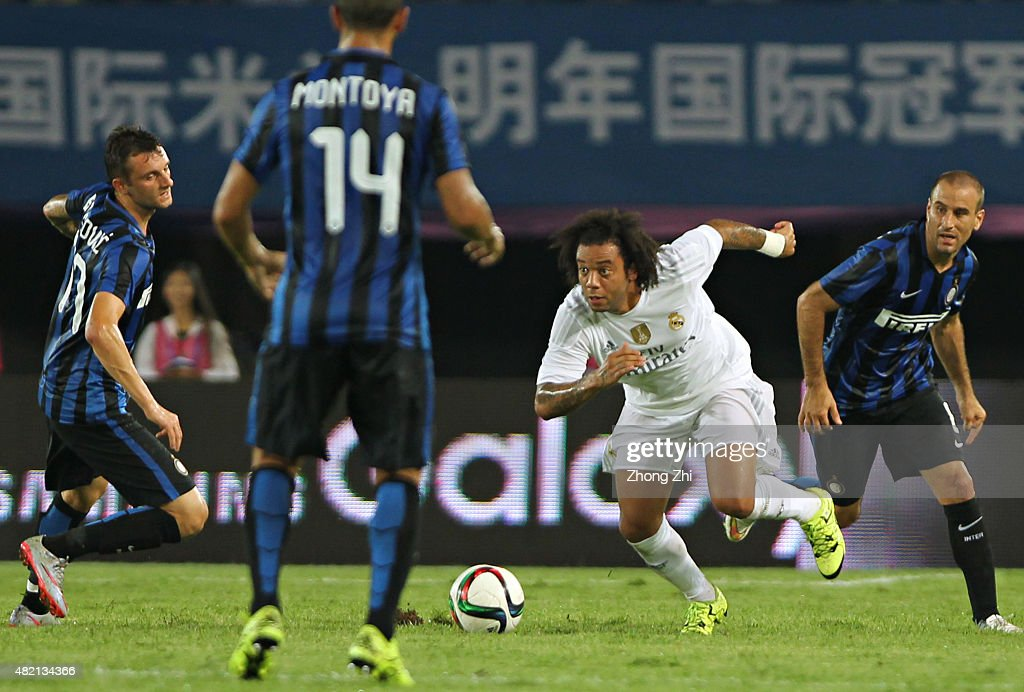 Marcelo of Real Madrid in action against Brozovic Marcelo of FC Internazionale during the match of International Champions Cup China 2015 between Real Madrid and FC Internazionale at Tianhe Stadium on July 27, 2015 in Guangzhou, China.