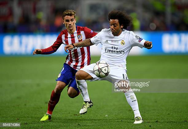 Marcelo of Real Madrid is challenged by Antoine Griezmann of Atletico Madrid during the UEFA Champions League Final match between Real Madrid and...
