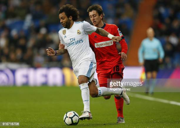 Marcelo of Real Madrid is chased by Mikel Oyarzabal of Real Sociedad during the La Liga match between Real Madrid and Real Sociedad at Estadio...