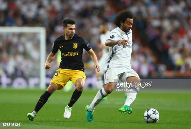 Marcelo of Real Madrid is chased by Nicolas Gaitan of Atletico Madrid during the UEFA Champions League semi final first leg match between Real Madrid...