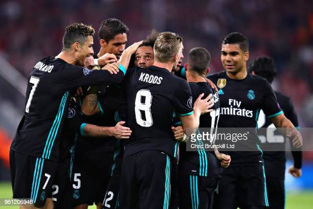 Marcelo of Real Madrid is mobbed by teammates after scoring his sides first goal during the UEFA Champions League Semi Final First Leg match between...