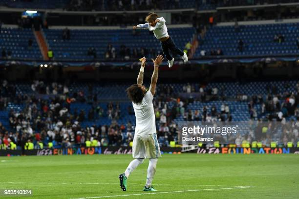 Marcelo of Real Madrid lifts his child into the air to celebrate victory after the UEFA Champions League Semi Final Second Leg match between Real...