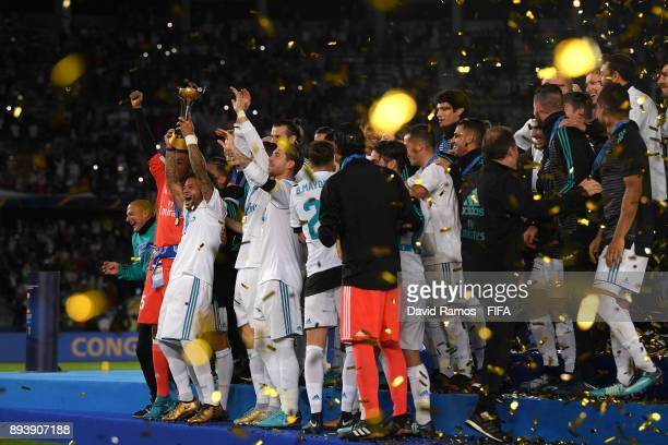 Marcelo of Real Madrid lifts the trophy after the FIFA Club World Cup UAE 2017 Final between Gremio and Real Madrid at the Zayed Sports City Stadium...