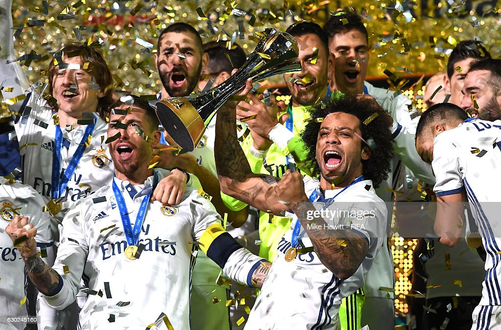 Marcelo of Real Madrid lifts the trophy as him and his team mates celebrate victory following the FIFA Club World Cup Final match between Real Madrid and Kashima Antlers at International Stadium Yokohama on December 18, 2016 in Yokohama, Japan.