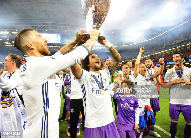 Marcelo of Real Madrid lifts the trophy as his side celebrate winning the 2017 UEFA Champions League during the UEFA Champions League Final match...