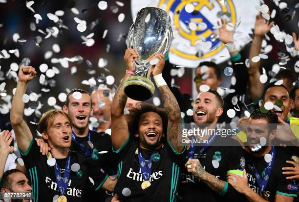 Marcelo of Real Madrid lifts The UEFA Super Cup trophy after the UEFA Super Cup final between Real Madrid and Manchester United at the Philip II...