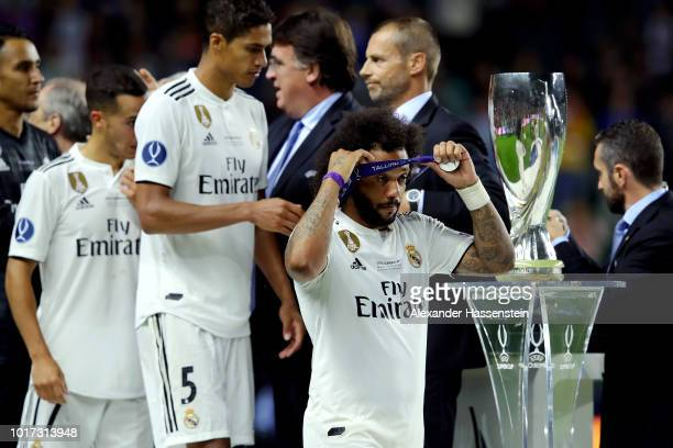 Marcelo of Real Madrid looks dejected as he walks past the trophy following the UEFA Super Cup between Real Madrid and Atletico Madrid at Lillekula...