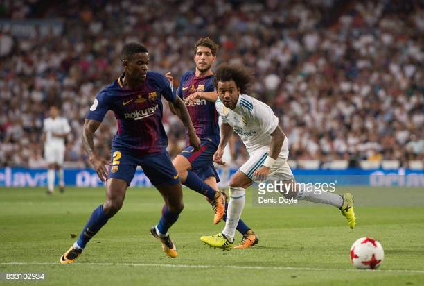 Marcelo of Real Madrid passes the ball away from Nelson Semedo of FC Barcelona during the Supercopa de Espana Final 2nd Leg match between Real Madrid...