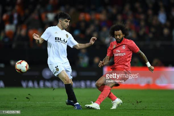 Marcelo of Real Madrid plays the ball forward under pressure from Carlos Soler of Valencia during the La Liga match between Valencia CF and Real...