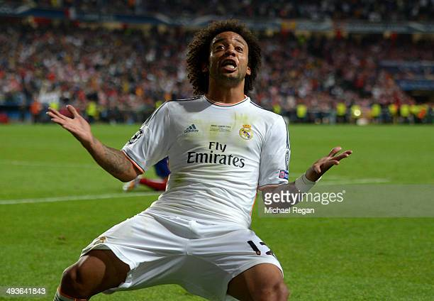 Marcelo of Real Madrid reacts after Gareth Bale of Real Madrid scored their second goal during the UEFA Champions League Final between Real Madrid...