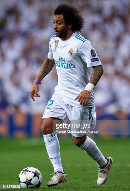 Marcelo of Real Madrid runs with the ball during the UEFA Champions League Round of 16 First Leg match between Real Madrid and Paris SaintGermain at...