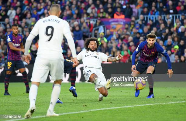 Marcelo of Real Madrid scores his sides first goal during the La Liga match between FC Barcelona and Real Madrid CF at Camp Nou on October 28 2018 in...
