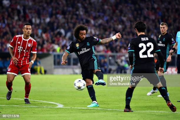 Marcelo of Real Madrid scores his sides first goal during the UEFA Champions League Semi Final First Leg match between Bayern Muenchen and Real...