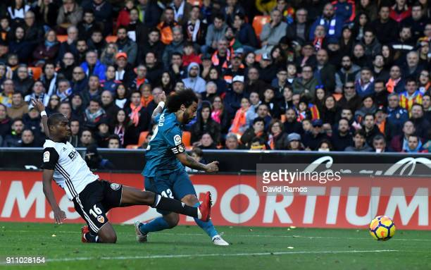 Marcelo of Real Madrid scores his sides third goal during the La Liga match between Valencia and Real Madrid at Estadio Mestalla on January 27 2018...