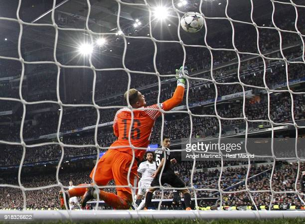Marcelo of Real Madrid scores his team's third goal past Alphonse Areola of Paris SaintGermain during the UEFA Champions League Round of 16 First Leg...