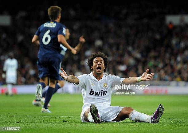 Marcelo of Real Madrid sits on the pitch as he reacts during the la Liga match between Real Madrid CF and Malaga CF at the Estadio Santiago Bernabeu...
