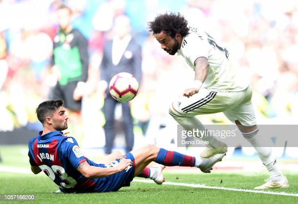 Marcelo of Real Madrid skips past Jason of Levante during the La Liga match between Real Madrid CF and Levante UD at Estadio Santiago Bernabeu on...