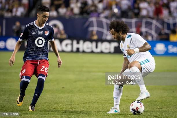 Marcelo of Real Madrid stops the ball before going up against Miguel Almiron of United States during the MLS All Star match between the MLS All Stars...