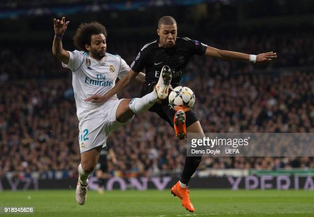 Marcelo of Real Madrid tackles Kylian Mbappe of Paris SaintGermain during the UEFA Champions League Round of 16 First Leg match between Real Madrid...