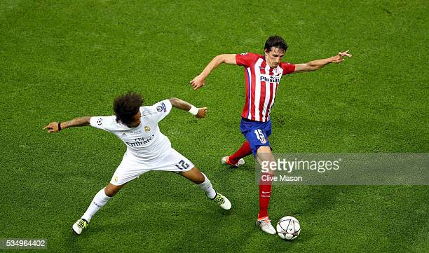 Marcelo of Real Madrid tackles Stefan Savic of Atletico Madrid during the UEFA Champions League Final match between Real Madrid and Club Atletico de...