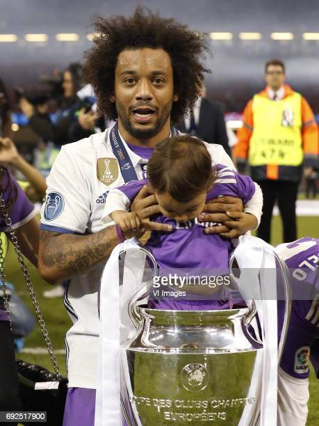 Marcelo of Real Madrid with his son with Champions League trophy Coupe des clubs Champions Europeensduring the UEFA Champions League final match...