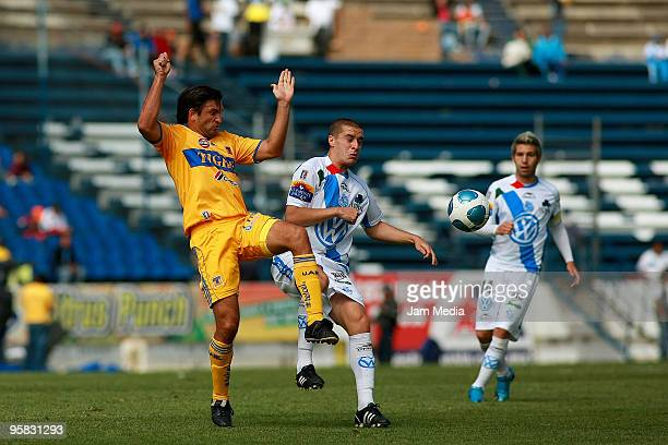 Marcelo Palau of Puebla vies for the ball with Francisco Fonseca of Tigres during a match as part of the 2010 Bicentenary Tournament in the Mexican...