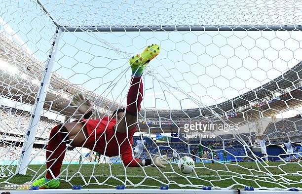 Marcelo Pereira, not pictured, of Honduras scores their second goal past Farid Chaal of Algeria during the Men's Group D first round match between...