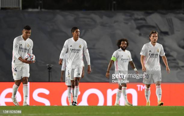 Marcelo, Raphael Varane, Luka Modric and Carlos Casimiro of Real Madrid look dejected after conceding a third goal during the UEFA Champions League...