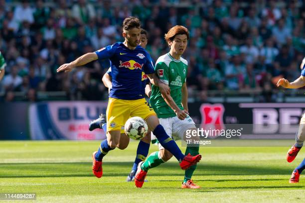 Marcelo Saracchi of RB Leipzig and Yuya Osako of SV Werder Bremen battle for the ball during the Bundesliga match between SV Werder Bremen and RB...